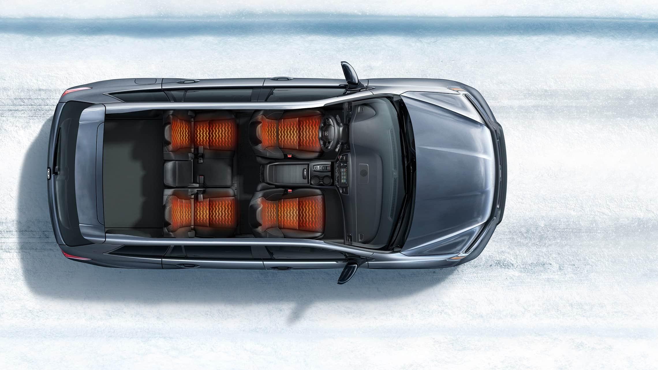 Vista aérea de la Honda Passport Elite2019 que muestra asientos calefaccionados en un entorno de caminos nevados.