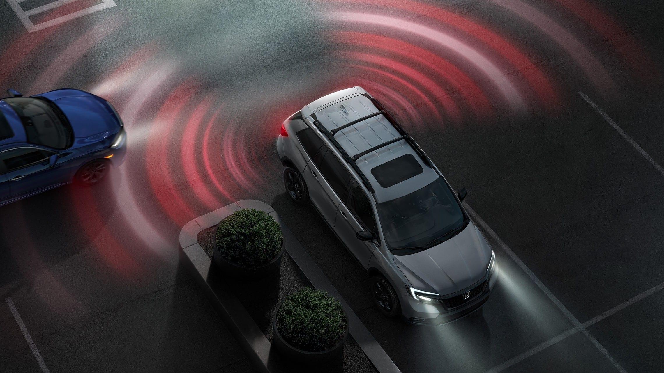 Vista interior de cámara de reversa multiángulo del sistema de audio en pantalla táctil de la Honda Passport Elite2019.