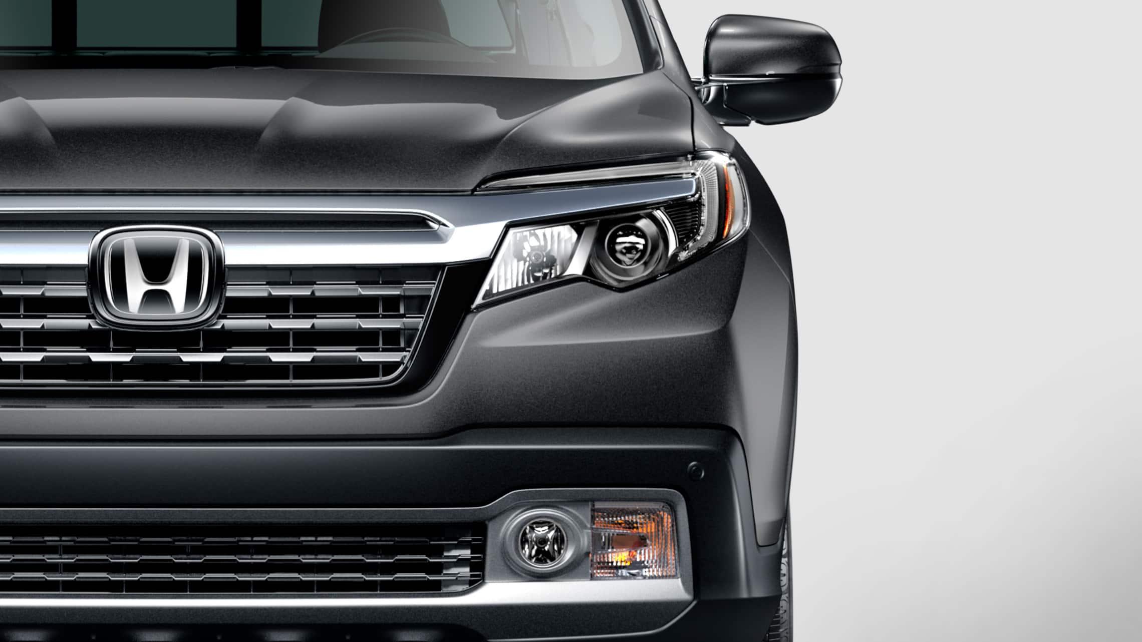 Detalle de las luces delanteras de LED en la Honda Ridgeline RTL-E2020 en Modern Steel Metallic.