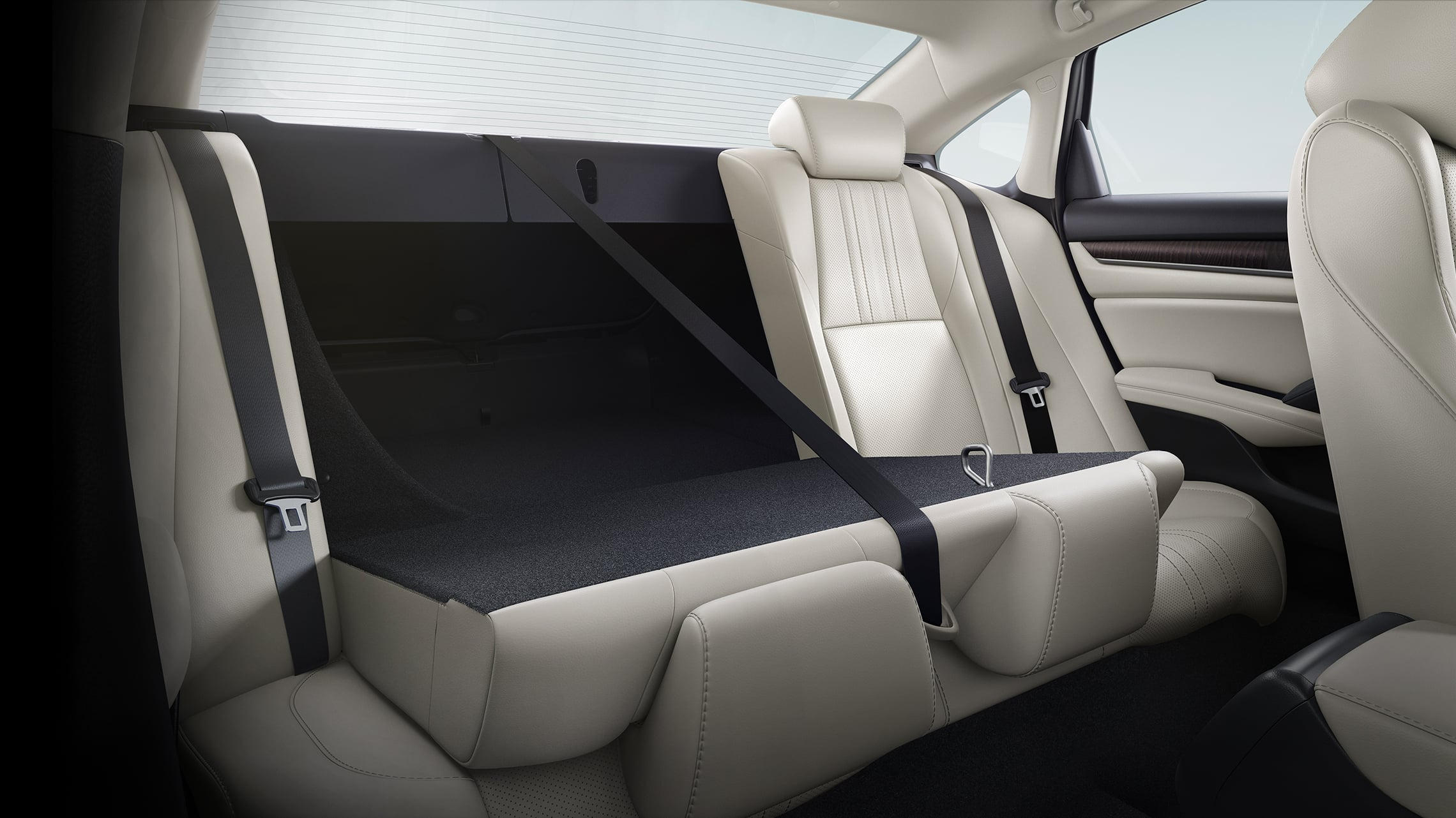 60/40 split fold-down rear seatback detail, shown partly folded down, in the 2021 Honda Accord Touring 2.0T with Ivory Leather.