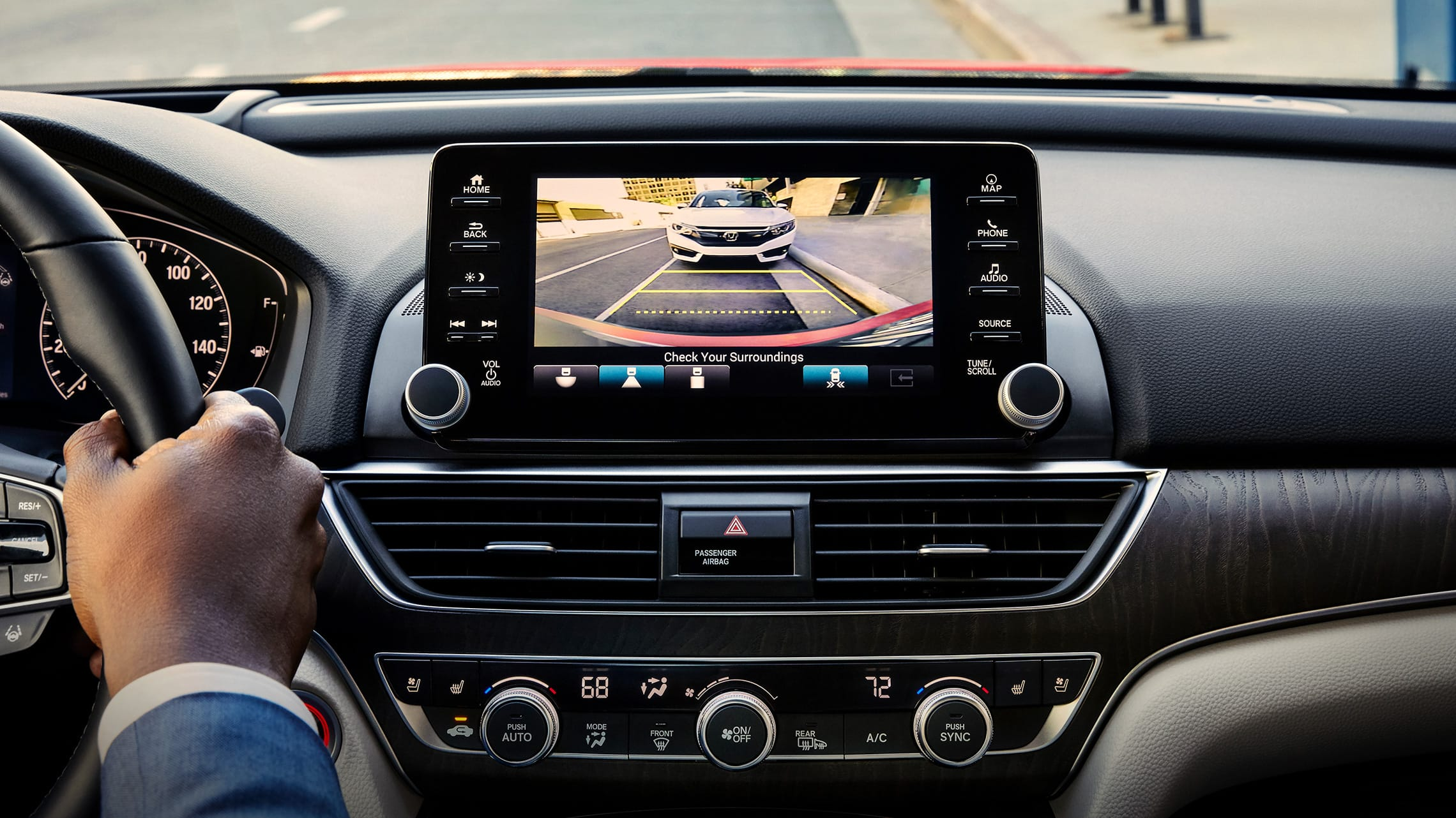 Detail of the Accord Display Audio touch-screen demonstrating the functionality of the Low-Speed Braking Control feature.