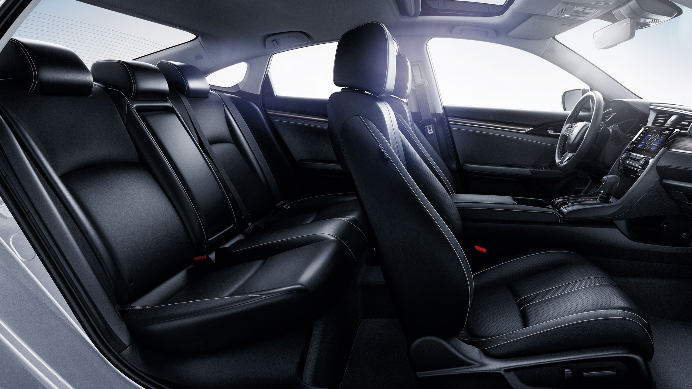Passenger-side interior view of the 2021 Honda Civic Touring Sedan with Black Leather.
