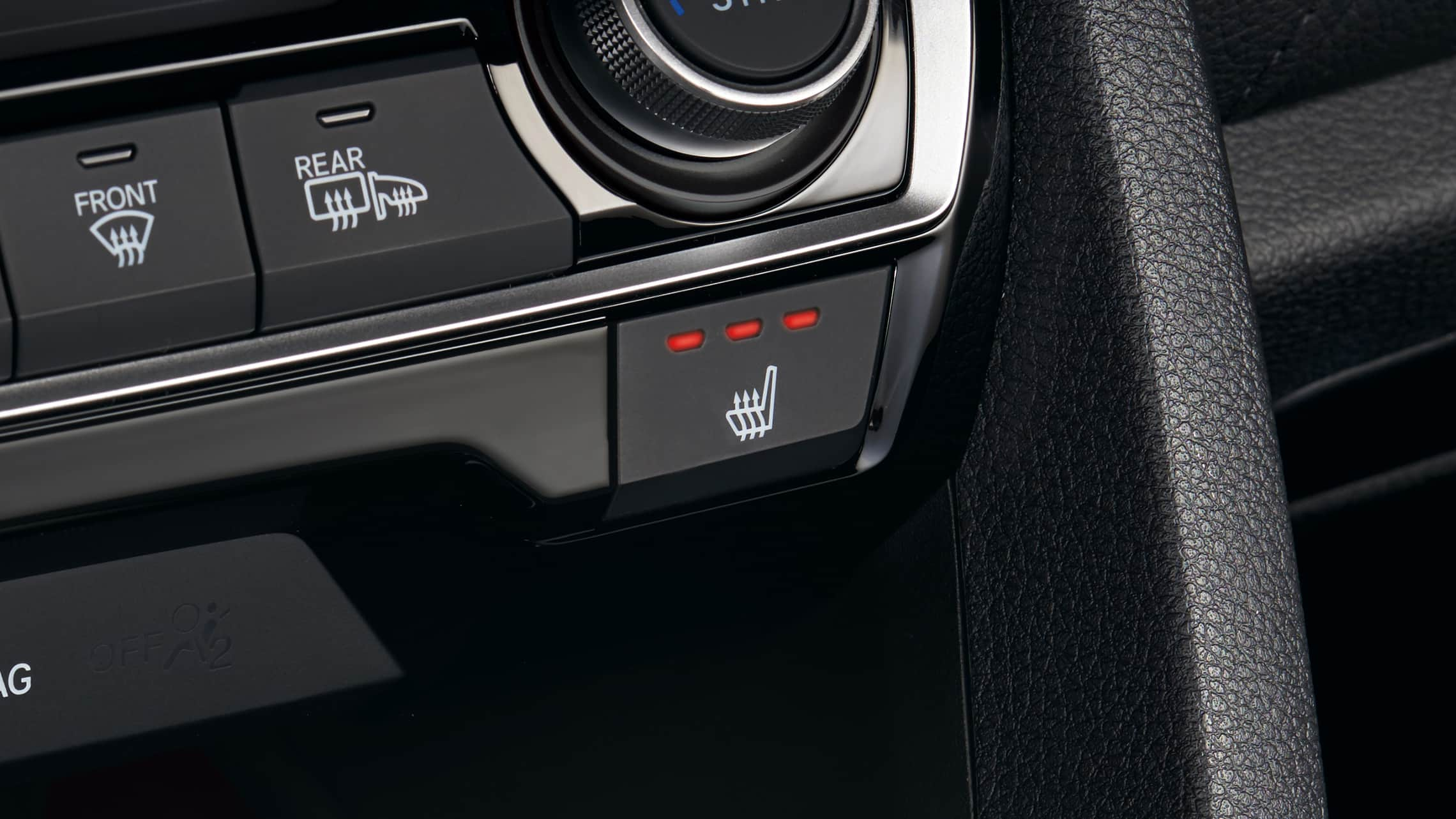 Detail of heated front-seat buttons in the 2021 Honda Civic Touring Sedan.