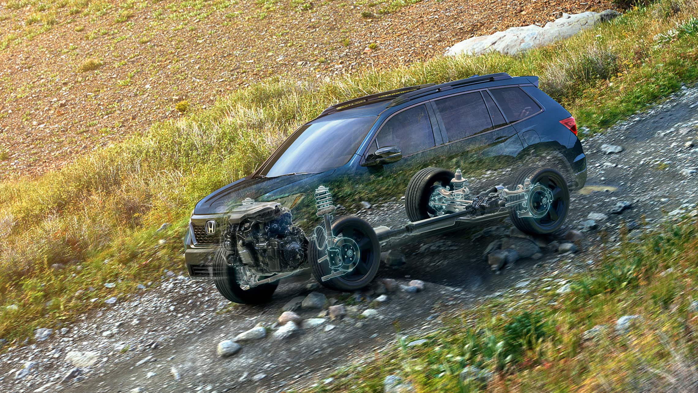 Click to play video of the 2021 Honda Passport driving through rocky terrain, with cutaway graphics displaying 4-wheel independent suspension in action.